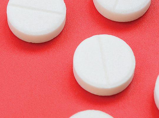 Close-up of small, white prescription pills