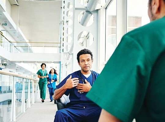 Doctors having a discussion in a hallway