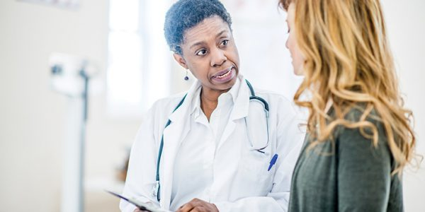 Doctor explaining something to her patient