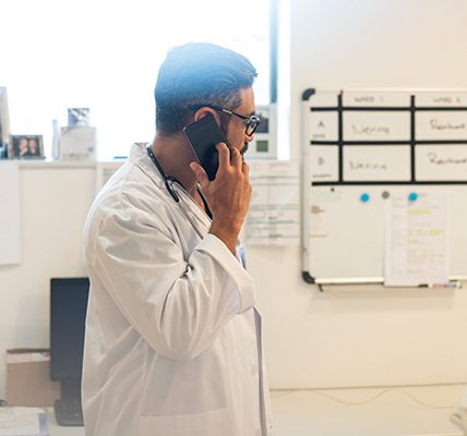 Physician on the phone in their office