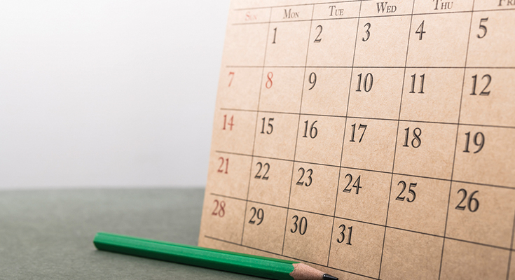 Hand-drawn calendar on a piece of cardboard