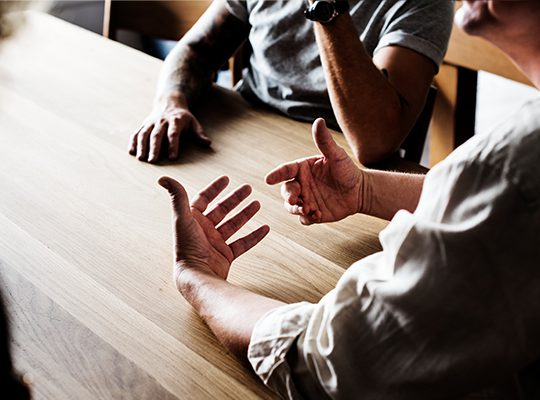 People having a discussion at a table