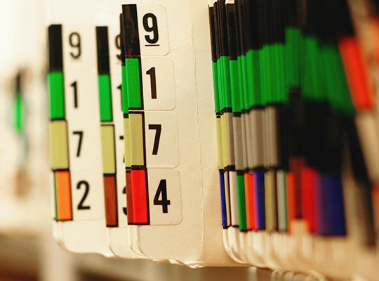 Numbered patient charts on a shelf