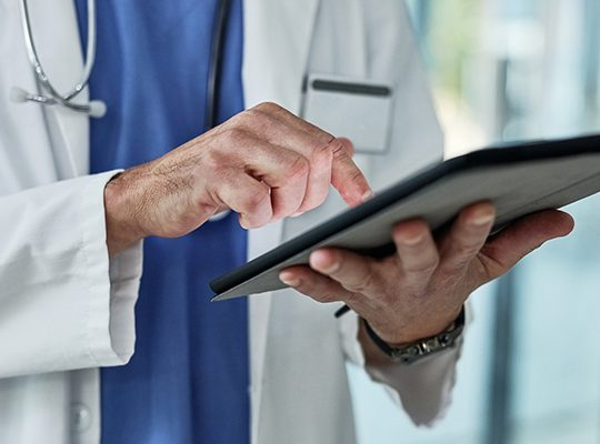 Close-up of physician using iPad