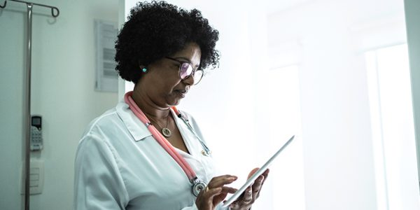 Female physician looking at electronic tablet
