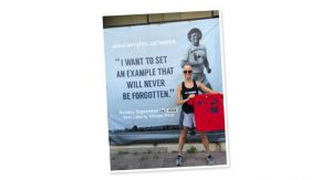 "Photo of Dr. Barbara Tatham in front of a poster of Terry Fox with the quote: ""I want to set an example that will never be forgotten."""