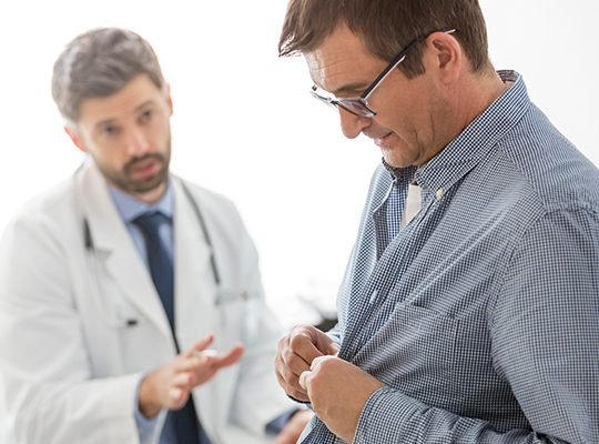 A doctor that appears to be trying to advise a patient against something