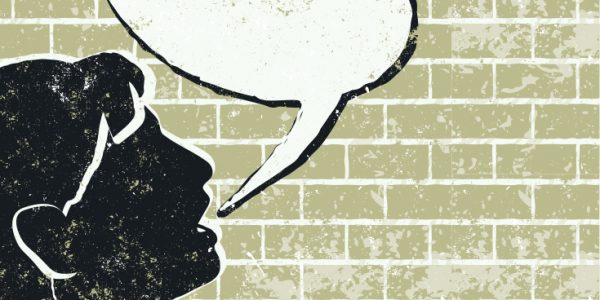 A silhouette of a person's end with an empty speech bubble