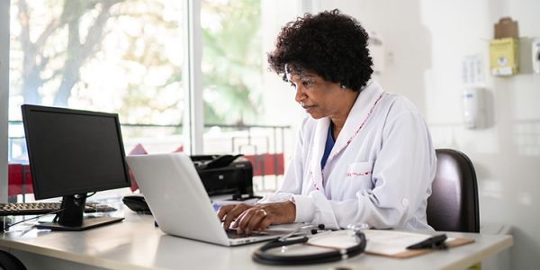 Physician interacting with a laptop