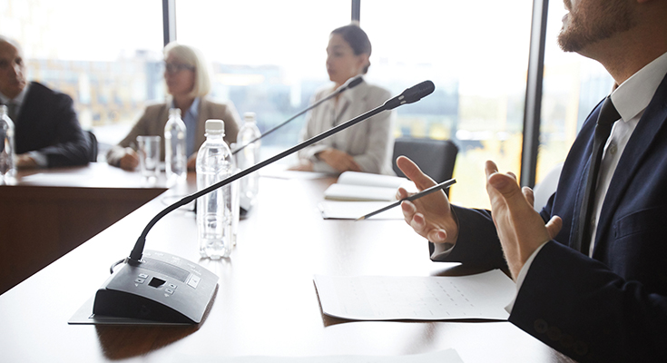 People sitting around a conference table