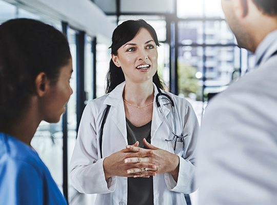 Healthcare professionals in discussion