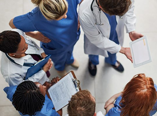Group of physicians in a circle discussing something