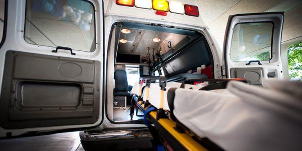 A gurney at the back entrance of an ambulance