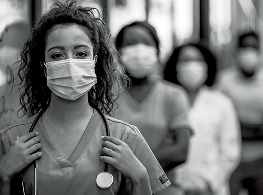 Black-and-white photo of healthcare workers wearing masks